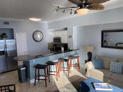Kitchen area with seating for 6. New stainless appliances. Fully stocked