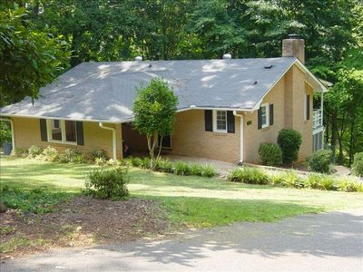 Brick home is situated in a beautiful, quiet wooded setting, close to boat ramp.