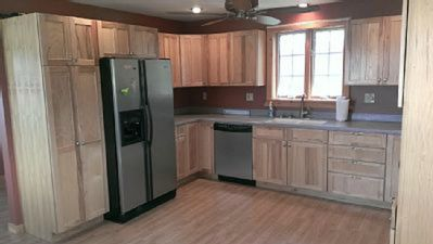i/2 of huge kitchen:Custom-built cabinets,sunny window, pantry (sliding shelves)