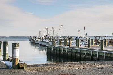 The home is situated across the street from the water and close to the marina!