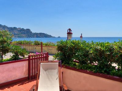 Photo for Romantic terrace front the sea