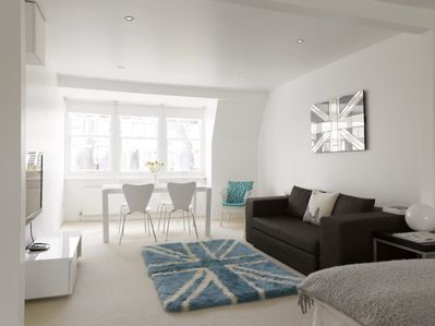 Living area. Large screen TV with cable/satelite channels and Sofa Bed.