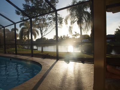 View of the canal at sunset from the lanai.