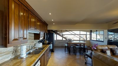 Open kitchen with shared living and dining area