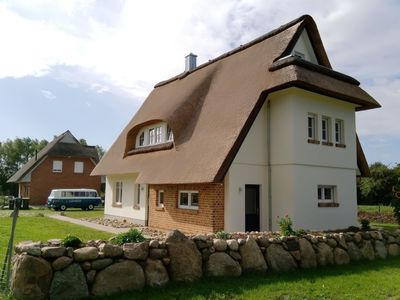 Photo for Thatched roof holiday home with 5 bedrooms, 3 bathrooms, sauna, 3 terraces