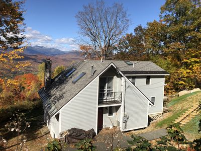 Watch the sun set over Mt. Washington from the deck of this mountain-top home!