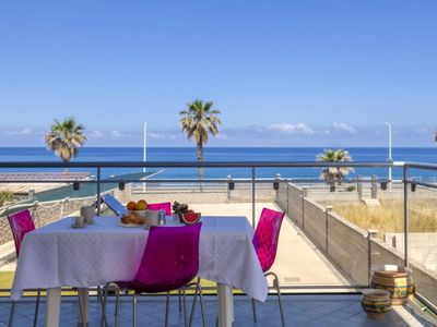 Photo for Glicine - 2-bedroom apartment  with large panoramic sea view terrace and pool in the garden