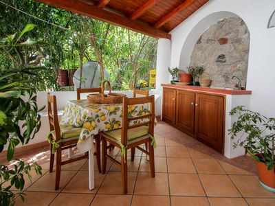 Photo for Beautiful studio with a covered terrace - walk to the beach!