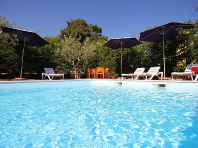 Photo for Magnificent apartment with pool near the sandy beach with air conditioning, WiFi and a nice barbecue area