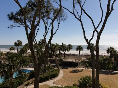 Photo for Superb condo w/ hot tub & pool - walking distance to the beach