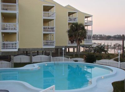 Large balcony overlooking pool, docks and Old River.