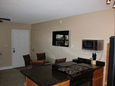 Flat screen cable TV and dining area