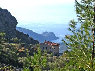 Photo for Romantic chalet on the mountainside with sea views