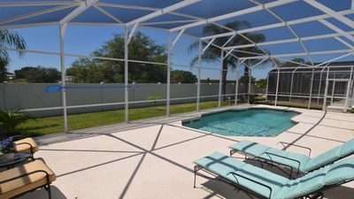 South-facing pool deck with loungers and no rear neighbours