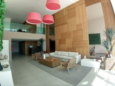 Photo for APTO PRAIA DO FORTE, NEAR THE DUNES. WITH SWIMMING POOL, ACADEMY, SAUNA, NEW BUILDING