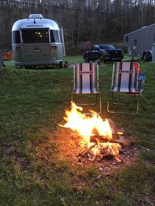 Each Airstream has a wood burning fire pit / ring and a charcoal BBQ grill