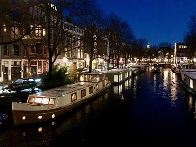 Photo for Luxury houseboat in historic, old city, Amsterdam.