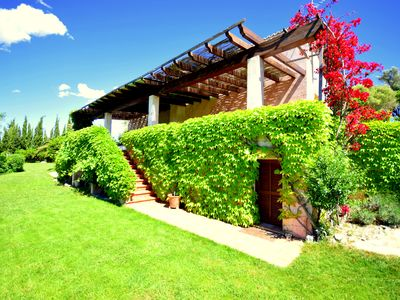 Photo for Fantastic island view, quiet secluded location, WIFI, pool, satellite TV, BBQ, terraces