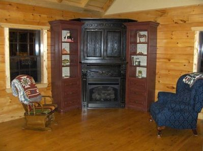 The Entertainment Center offers Gas Fireplace, Antique Distressed Mantel, & TV.