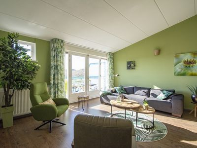 Photo for Spacious, luxurious and modern holiday apartment with balcony in Julianadorp aan Zee.