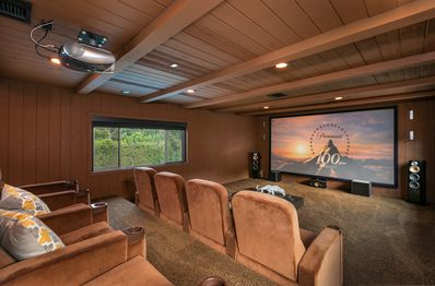 Theater Room - Gather in the theater room and enjoy a film on the projection screen.
