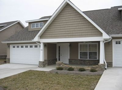One level ranch cottage with two car garage and covered front porch
