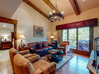 Photo for Stylish ski-in/ski-out condo w/ balcony, fireplace, & shared pool and hot tubs!