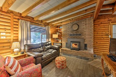 Turn on the wood-burning fireplace and relax in the living room.