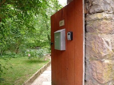 Photo for Romantic - River Bank Getaway - Outdoor cooking - NEW Italian Shower - WIFI