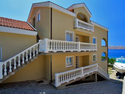 Photo for Right on the private beach with stunning sea views - Apartment Luca