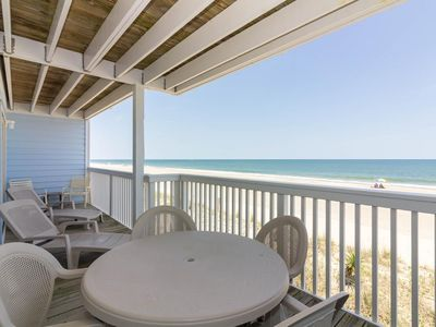 Photo for Watch the children play in the sand from the decks of this oceanfront condo
