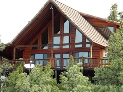 Chalet in the pines with view of ponderosa studded mountains on 2.5 acres.