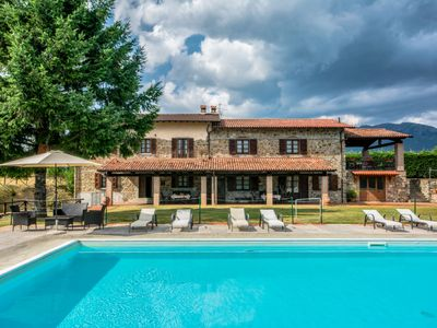 Photo for 8 bedroom Villa, sleeps 16 with Pool, WiFi and Walk to Shops