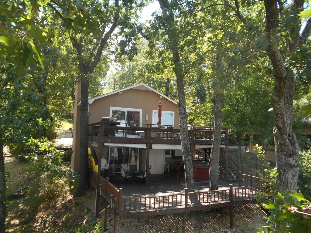 rental modern on grand cove beautiful secluded ok cabins holiday rentals lake dock boat eucha house cabin