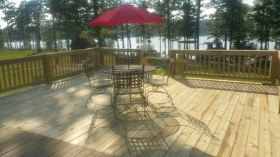 Sit on the deck and enjoy the view of the lake and wonderful sunset.