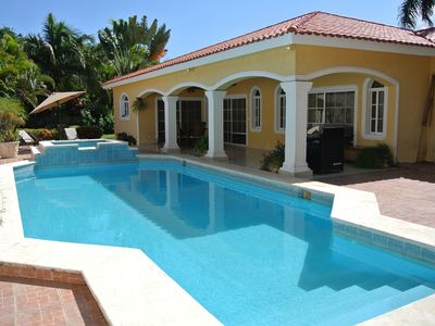 Photo for Guest-friendly villa with private pool and garden in beachfront residence