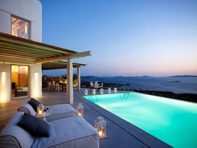 Photo for Amazing Villa Amasa in Mykonos, with stunning sunset and Delos view.  Private swimming Pools, Up to 18 Guests 9 Bedrooms 9 Bathrooms