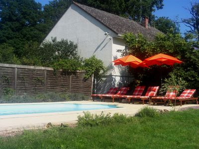 The swimming pool with deckchairs