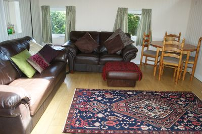 comfortable well furnished front room with flat screen TV and digital radio