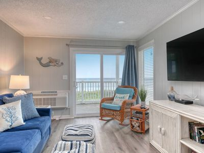 Photo for Corner View Ocean Front Condo with Stunning Views- Private access to the beach!!