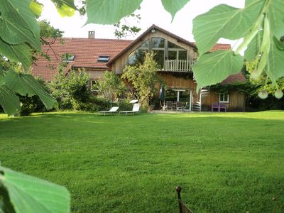 Photo for Holiday house with large garden, two separate living areas, jacuzzi and sauna!