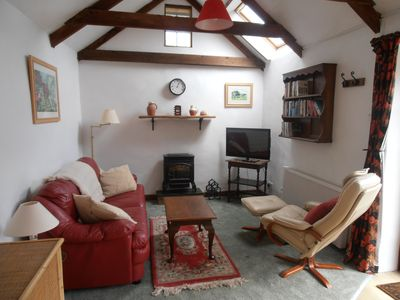 The sitting room with its gas fire and comfy seating