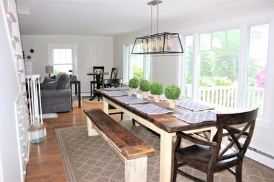 Elegant farm table made from reclaimed wood with plenty of seating and a view