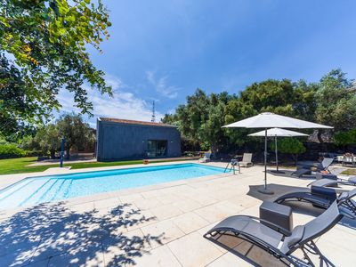 Photo for Elegant, private pool, surrounded by greenery and close to the city