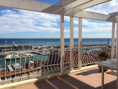 Photo for Cassis, on the port, top floor with large terrace and sea view 180 °