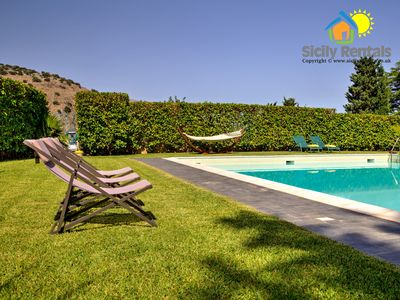 Photo for Large villa with a beautiful swimming pool surrounded by a lush garden