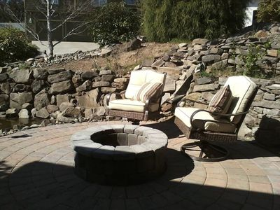 Relax in outdoor area with waterfalls, pond