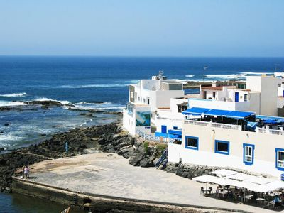 Photo for Charming Apartment Abuelo Miguel On the Beach with Rooftop Terrace, Ocean View & Wi-Fi