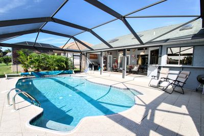 Sun-drenched pool deck with lounging and seating options