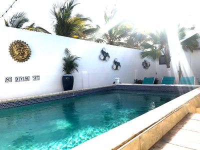 Photo for Large Villa 5 MINUTE WALK to RITZ & Marriott Beaches with in ground pool.